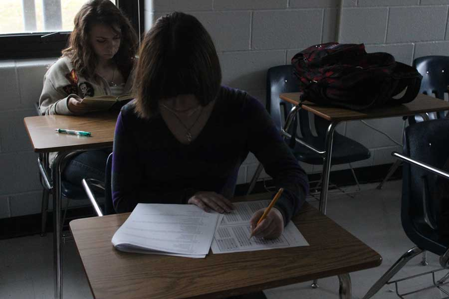 Students take a test in Mrs. Dennigman's AP Psychology class. Testing takes up much of their classtime and often times forces the lessons to be shortened.