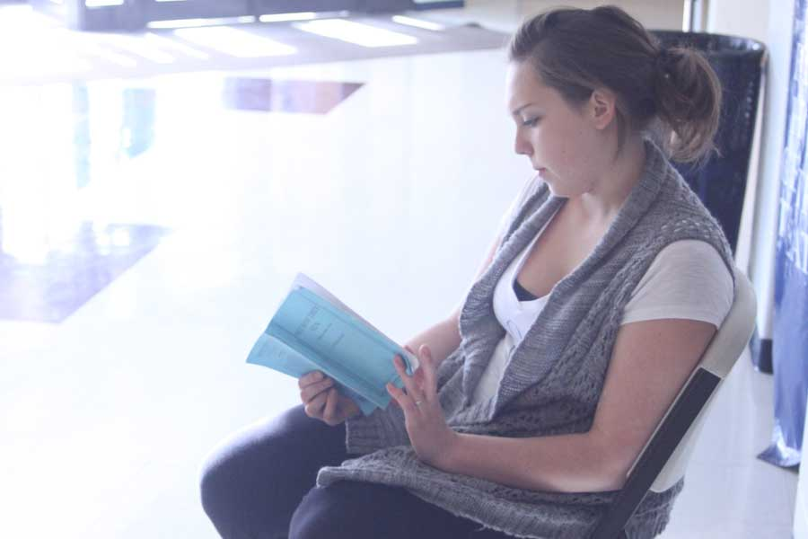 Hannah Beckmann reads over her lines during rehearsal for See How They Run. She played the part of Miss Skillon.