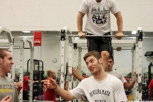 Weightlifting students pump iron