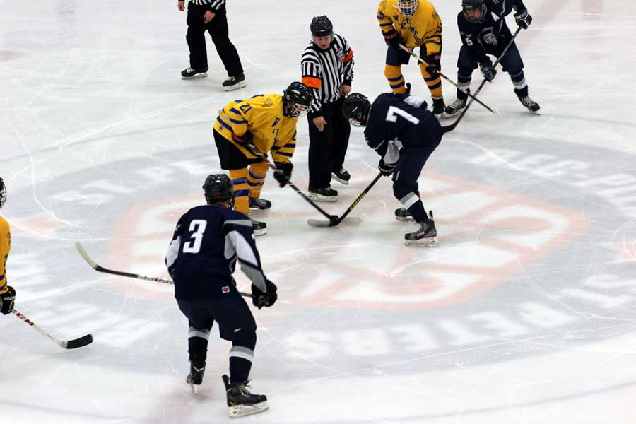 The Spartans face off for the puck at the beginning of the game. The Hockey team won their game against Holt 13-2.