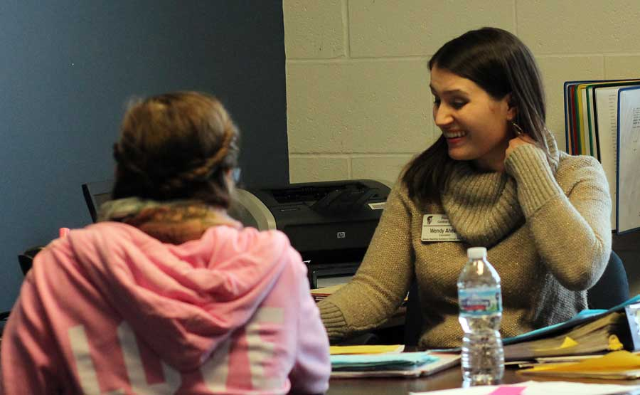 Guidance counselor Wendy Ahearn works with a student on her schedule for the 2014-15 school year on Friday, Jan. 17. The first two weeks back from winter break are traditionally the time of year students choose their courses for the coming school year, working with their guidance counselor to select just the right classes.