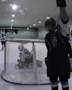 Varsity Hockey dominates Holt 14-2