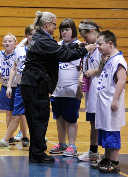 Competitors from the Special Olympics held in the large gym on Saturday,  Jan. 18 receive their medals from an official. Members of Student Council and the National Honor Society volunteered at the event, serving as referees, scorekeepers, team managers and fans for each team of athletes.
