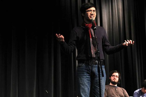 Chris Nguyen, a student at Washington University and member of WUSlam, the university's poetry slam group, gestures during his Feb. 28 performance in the auditorium. Breakdown FHC helped bring the group of three poets to school as part of Diversity Week.