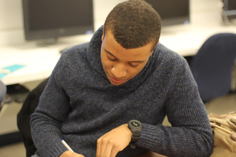 Senior Sean Earl works in Mr. Cross' marketing class, which is closely affiliated with the DECA program.