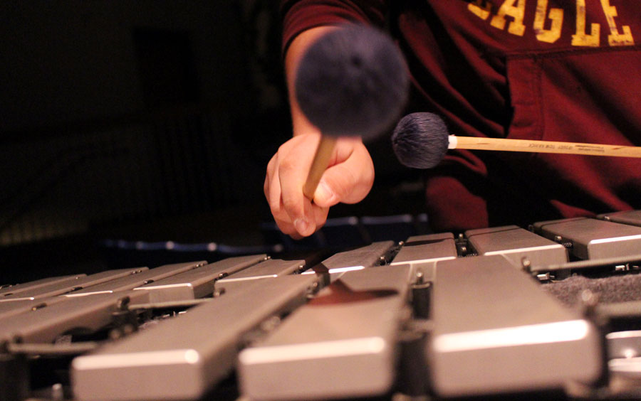 Drum+line+arrives+bright+and+early+to+practice+in+the+auditorium+++