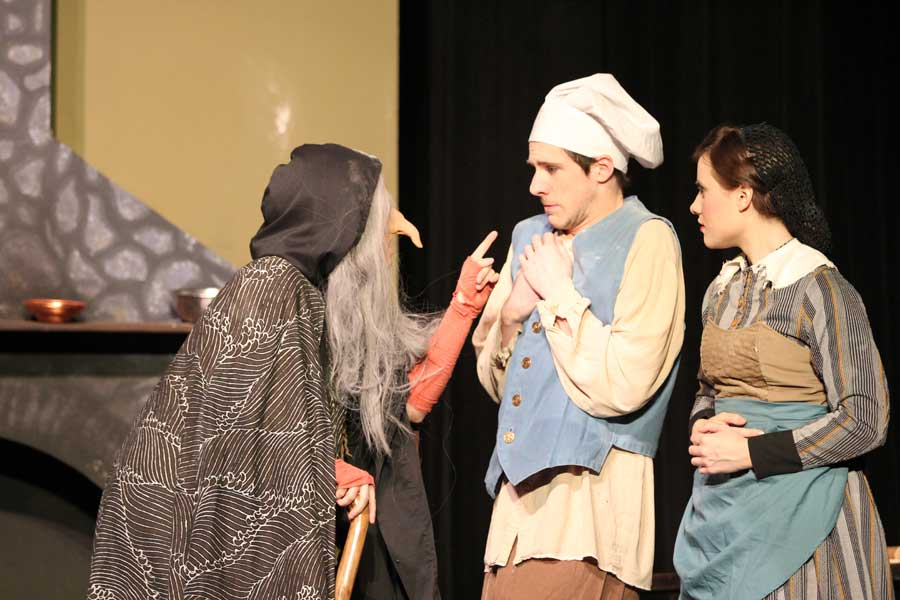 Senior John Emery and sophomore Esther Davis shrink away from a witch, played by senior Hailey Stephens. Returning Spotlight Players Emery and Davis play the baker and his wife in the musical