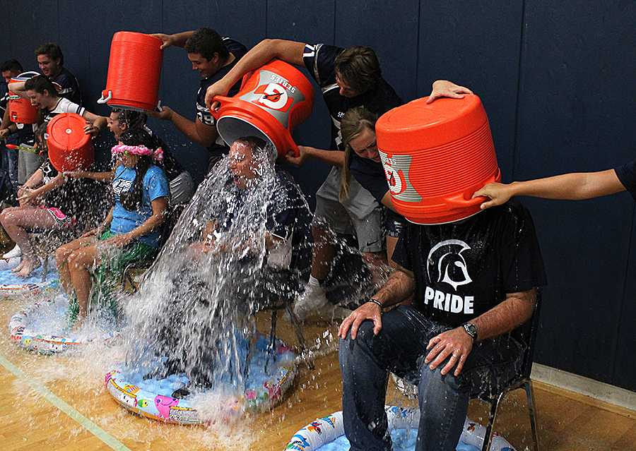 Water+pours+over+Ms.+Laurie+Fay%2C+Dr.+Sonny+Arnel+and+Mr.+Scott+Harris+during+the+Fox+2+Pep+Zone+rally+on+Friday%2C+Aug.+22.+
