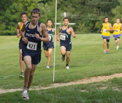 The boys cross country team races against Howell in their meet.