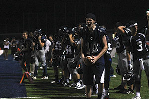The football team gets excited as they play Fort Zumwalt East on Aug. 22. They ended up losing the game 35-7.