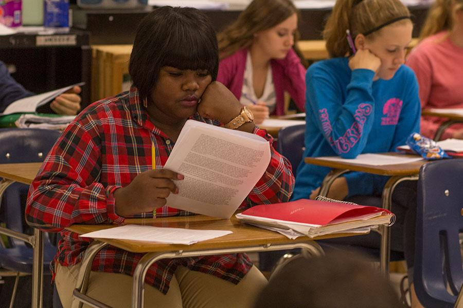 Junior Adrianne Jeffries reads through an article in Ms. Kim Okai's English III class on Wednesday. Jeffries enrolled at FHC shortly before fall break after being enrolled at Normandy High School.