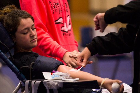 A student has blood drawn on  Tuesday, Oct. 28, for the annual blood drive. The blood drive was held in the small gym on Oct. 28 and was sponsored by StuCo.