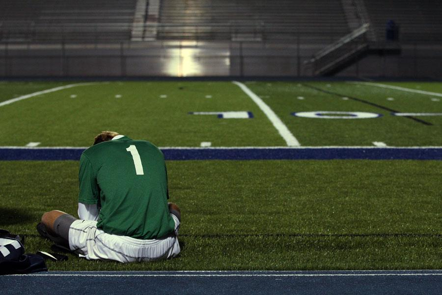 Senior goalkeeper Chase Webert slumps on the sideline after the Spartans loss against Lee's Summit. The team lost 2-1.