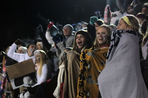 Student body stands by the boys soccer team's side despite frigid temperatures and long drive. Although the team had lost, the crowd never lost enthusiasm.