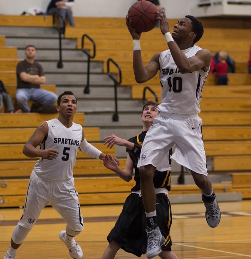 Varsity basketball tame Zumwalt East