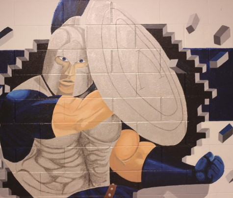 A mural at the top of the stairs by the art hallway. This was painted last year by Art Club.