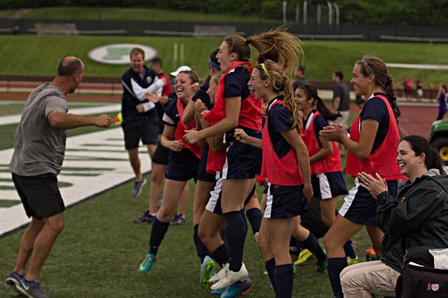 Coach Derek Phillips and the girls soccer team celebrate after senior Caitlyn Eddy scored from 30 yards out to give the Lady Spartans a 1-0 lead over the Pattonville Pirates on May 30. The Lady Spartans would add another goal later in the second half to seal their trip to the state semifinals on Friday.