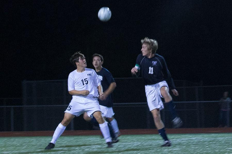 Sophomore+Joey+Mueller+prepares+to+leap+in+the+air+to+head+the+ball+against+Timberland.+The+Spartans+dominated+the+game%2C+winning+4-1.+