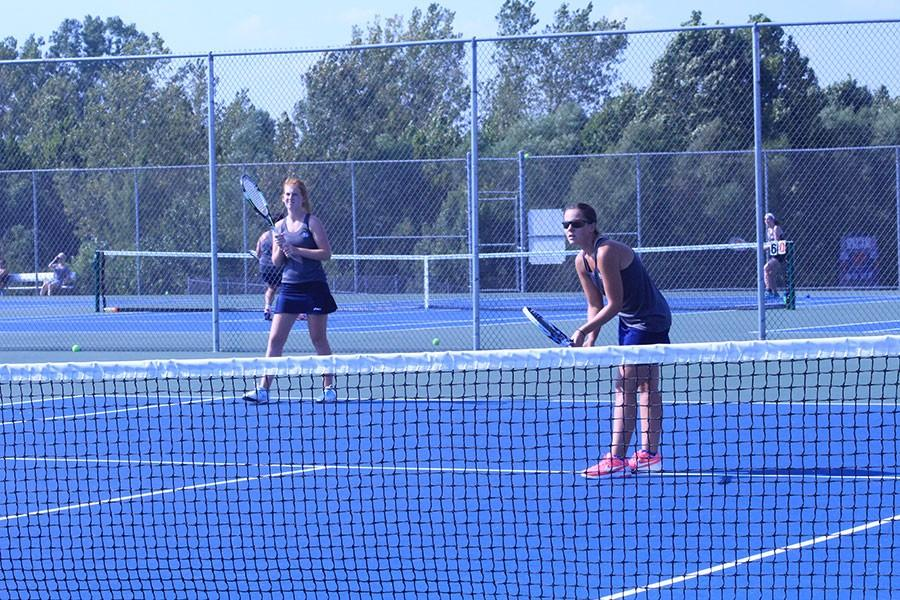 Senior Abby Conoyer and Junior Maddie Gunnell square off in a doubles match.