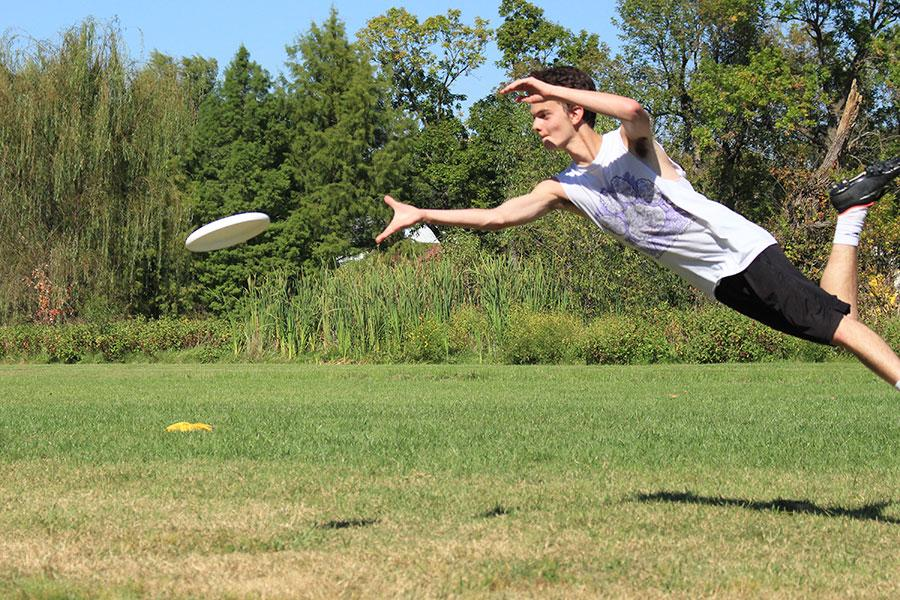 At the fall pick ups during a drill, junior Jake Hayden flies for a disc.  He caught the disc and won a point for his team in the drill.  This happened at Lions Park when ultimate frisbee had fall pickups.