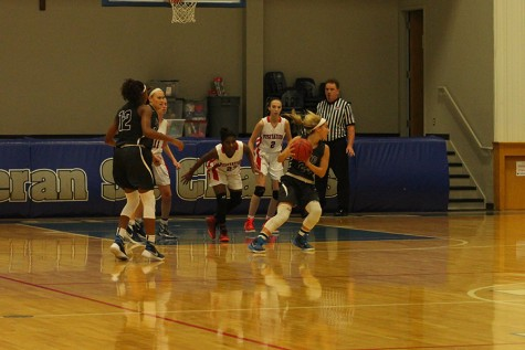 Emma Raup takes possession of the ball and looks for a pass.