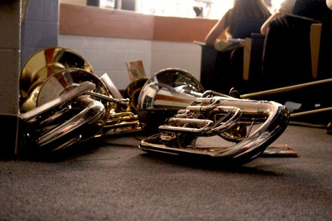 Band members instruments lie on the floor on Wednesday, Dec. 9 before the performances of the wind ensemble, concert band and symphonic band.