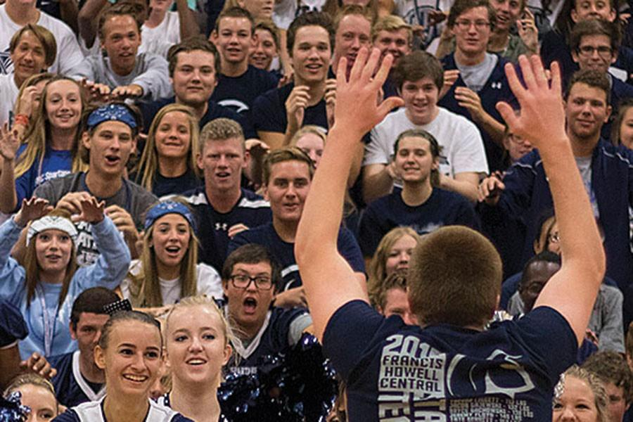 Members+of+the+crowd+at+the+pep+assembly+stare+intently+at+junior+Trent+Diener+as+he+leads+the+crowd+in+the+roller+coaster+chant+at+a+pep+assembly+in+August.+Diener+is+one+of+the+leaders+of+the+school+Pep+Club+and+helps+organize+the+%40FHCGetRowdy+Twitter+account.