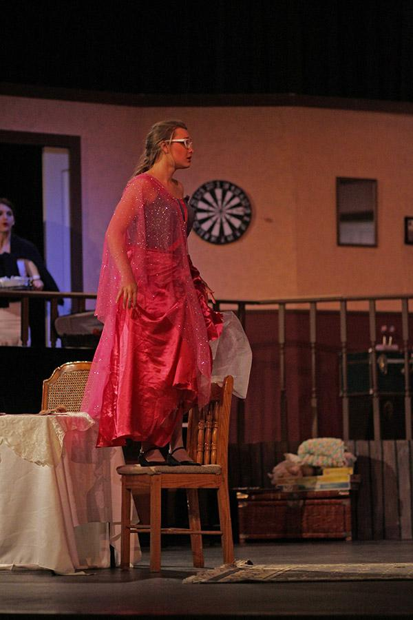 Rachel Fortney wears a princess costume and stands on a chair during