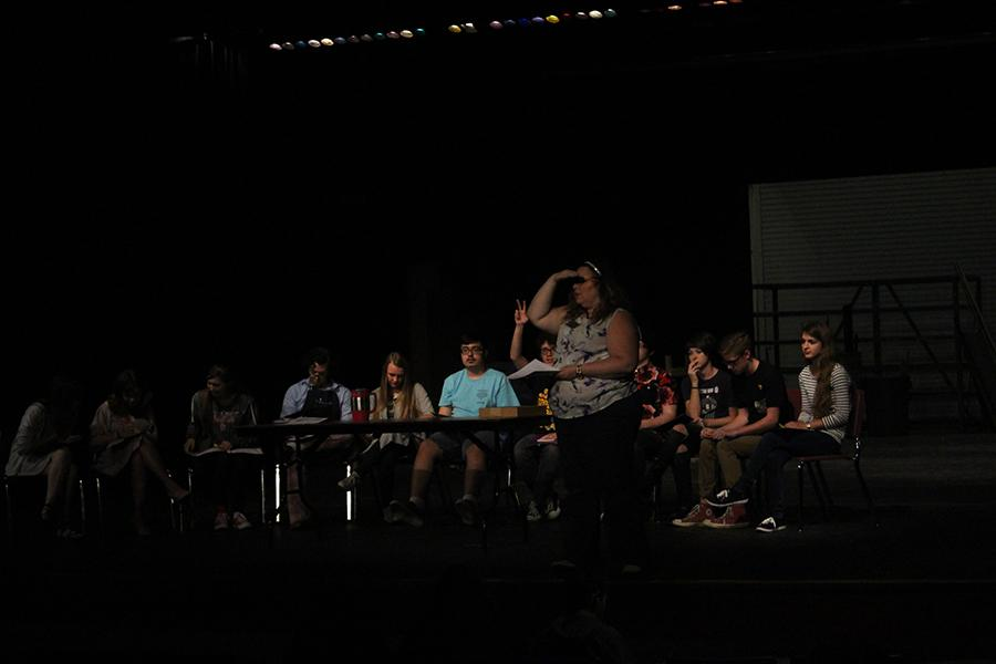 Mrs. Nelson and the cast do a script read through.