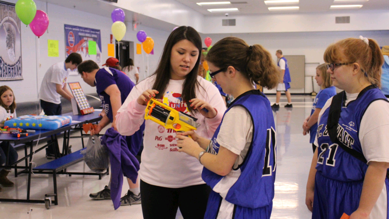 Senior Haley Clark helps student athlete navigate her way around the cafeteria. Haley has acted as a Stuco officer this school year.