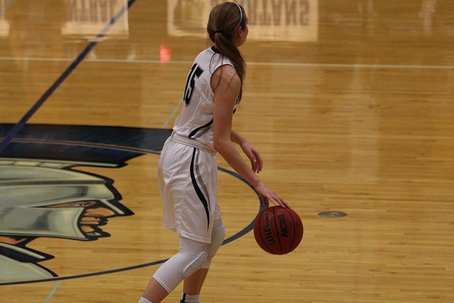 Lady spartan Lauren Ebert dribbles the ball across the court.