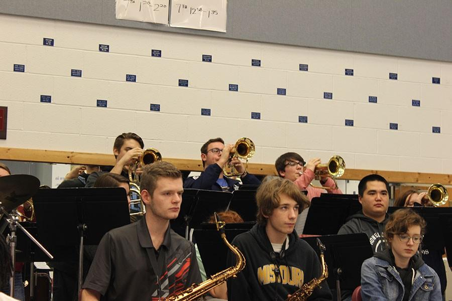 Band students, including senior Jared Tredway (second row, on right), practice during class.