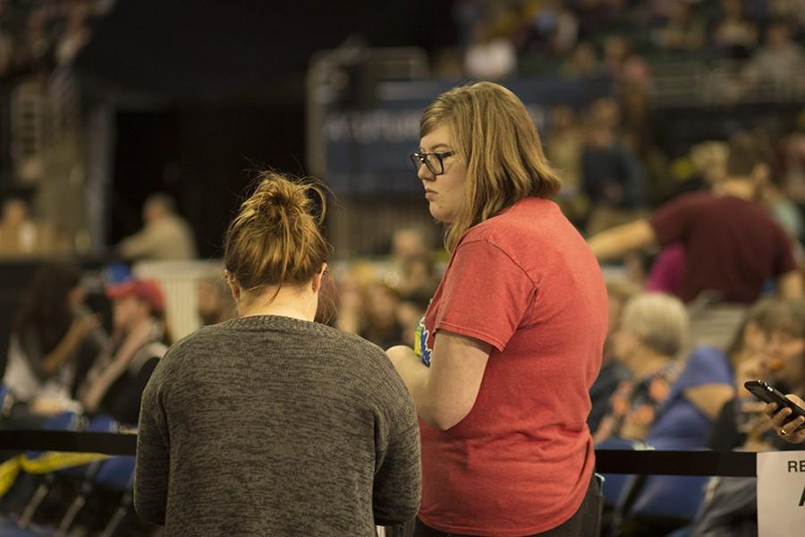 Elise Wantling talks to friend at the Family Arena for the Sen. Sanders rally that took place on March 14.