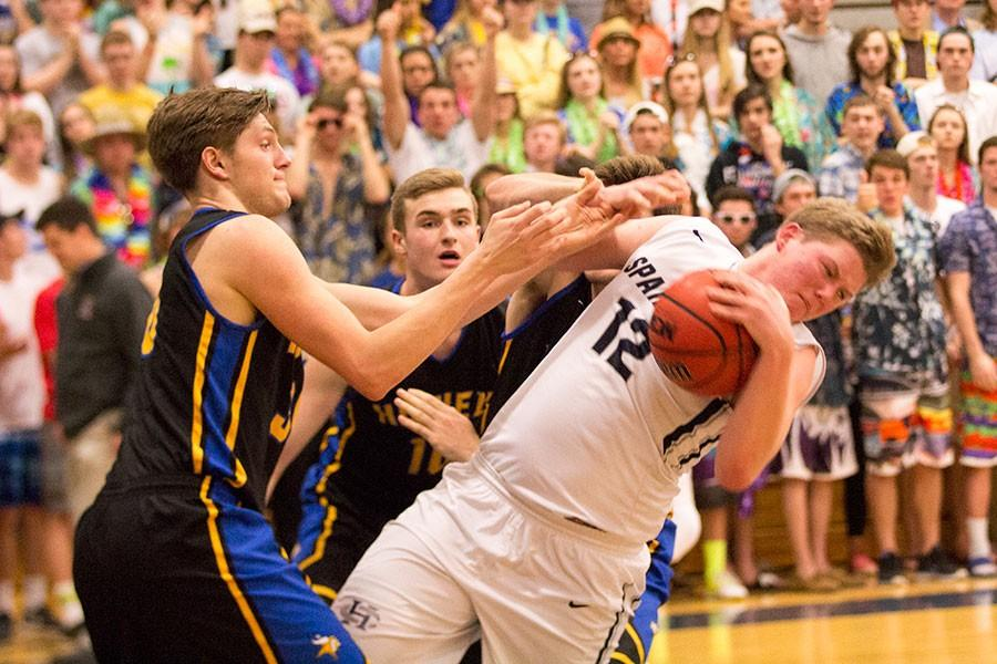 Senior Clark Hepler struggles to keep the ball away from a Howell guard.
