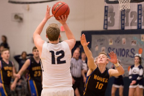 As Clark Hepler makes a shot, Howell's Zach Reader attempts to block his shot.