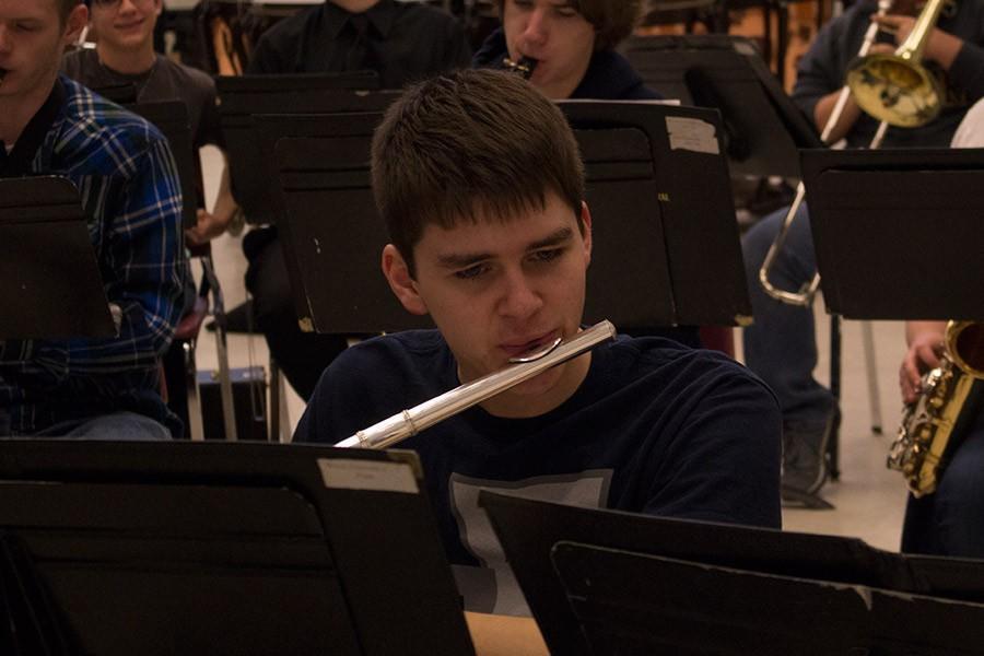 Senior+Jordan+Handley+plays+a+chorale+the+flute+in+the+Wind+Ensemble.