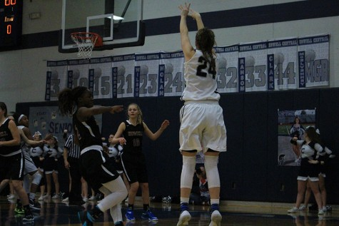 Senior Kaitlin Nolan shoots the basketball to score a basket for the Lady Spartans