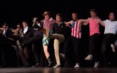 All the boys line up and dance a kick line as the song comes to an end