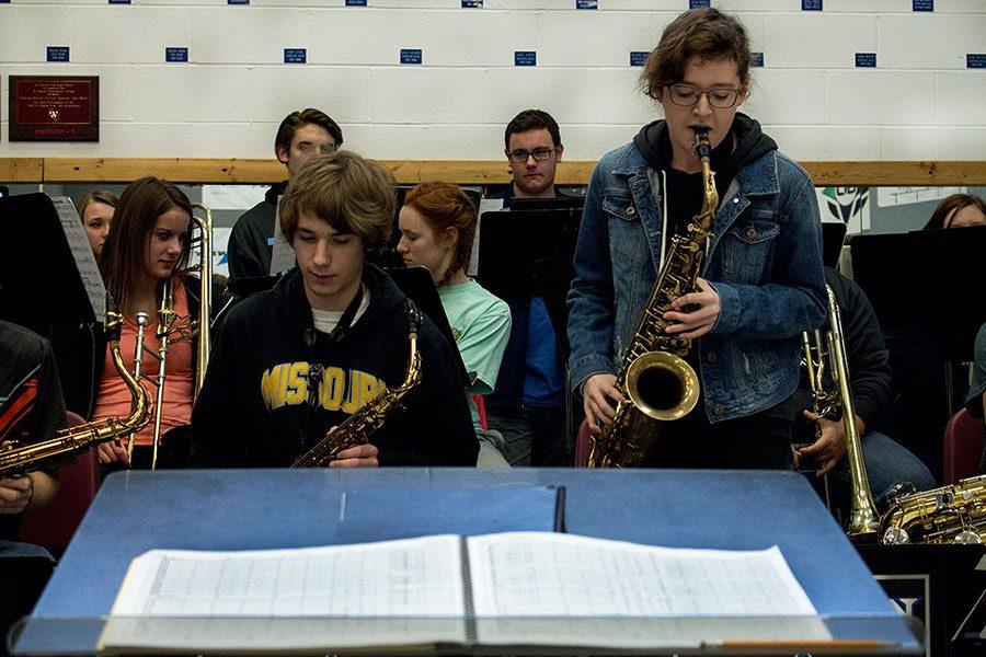 Jazz ensemble students, including junior Vivian Scott (right, standing), practice a piece.
