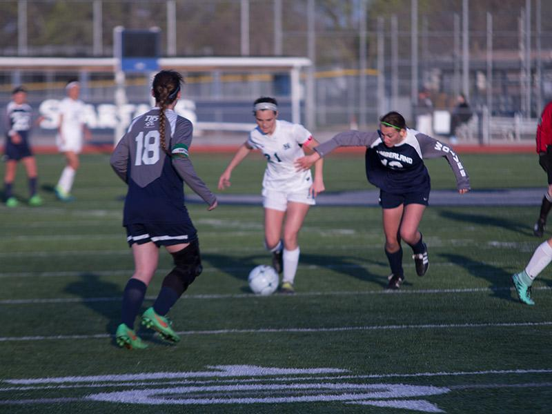 Emma Farley takes the ball to the goal. Farley scored one of the goals against Howell.