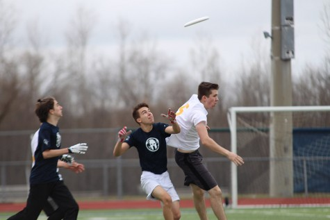 Senior Eric Gibbs prepares to catch the frisbee.