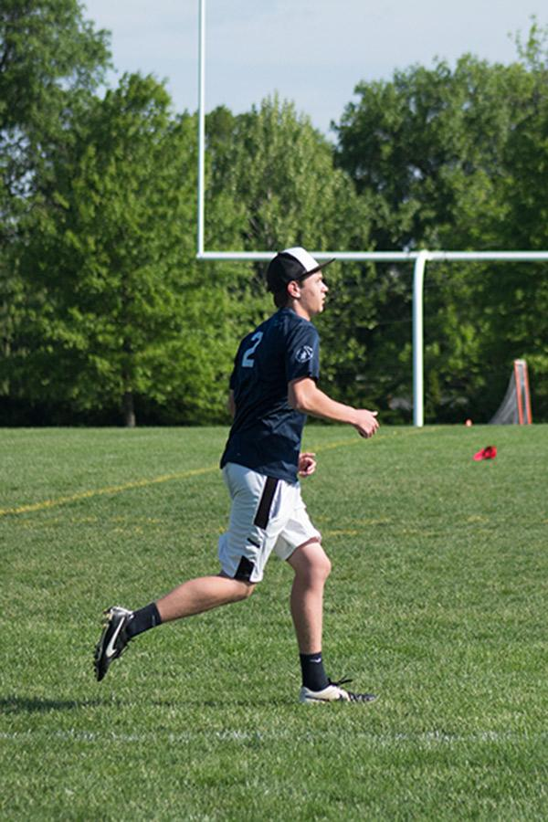 Tj Buchanan waits for a teammate to pass him the frisbee during state tournament.