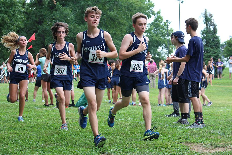 Members of the cross country team come down a straight portion of the course at McNair Park. The boys and girls teams have gotten off to strong starts in their first meets of the season.
