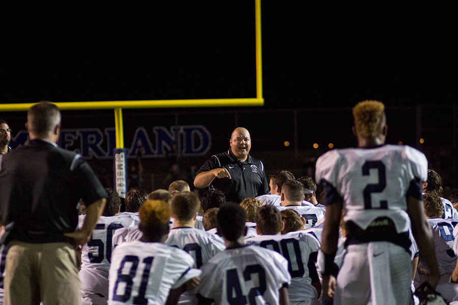 Head coach Pete Eberhardt speaks to his team after its loss to Timberland on Sept. 9. The Spartans will battle Francis Howell North this evening and try to even their season record at 3-3.