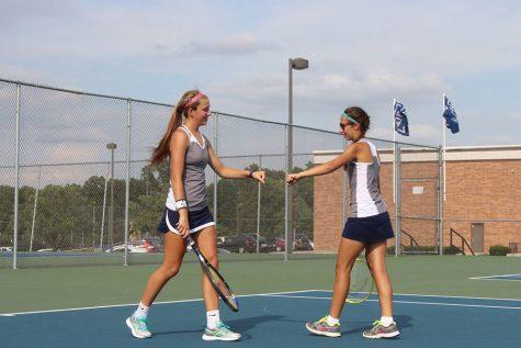 Girls tennis wins district title