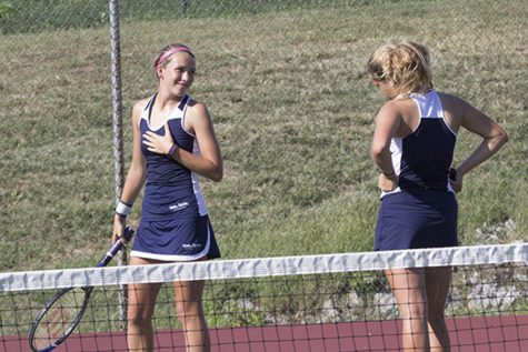 Senior Angel Ikeda and Freshman Mckenzie Jones share a laugh after a point was won on Saturday, September 24th at GAC's
