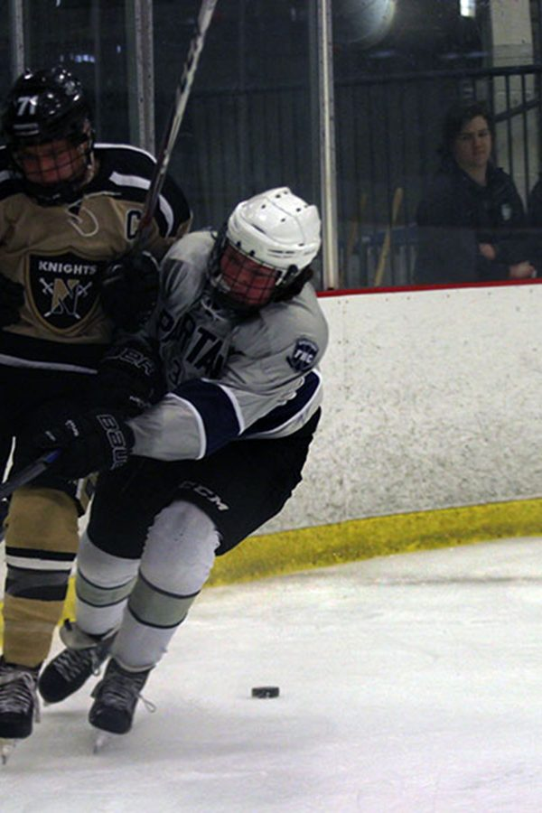 Spartans fight with the a Knight player against the wall. The Spartans beat North 5-2.