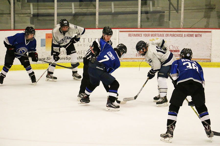 Gabe Vendetti faces off an opponent. The team has multiple games during winter break.