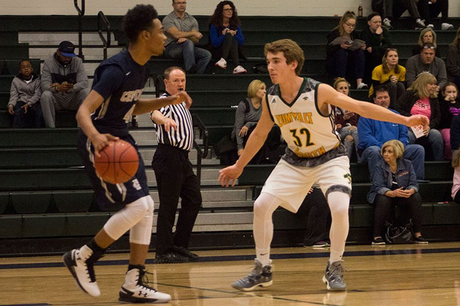 Senior+Marcus+James+bounces+up+court.+He+scored+27+of+the+60+points+for+the+Spartans%2C+who+will+advanced+to+take+on+Timberland+this+evening.