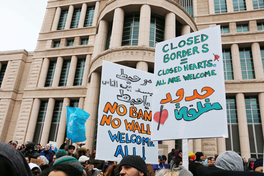 Protesters on 10th street holding signs on Feb. 4th to contradict the ban on refugees.